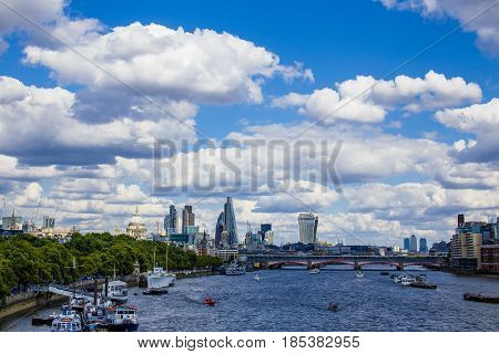 View Of London's Cityscape From The River Thames, Including The Tower Bridge