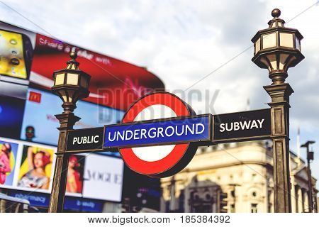 Underground Sign In Central London In Piccadilly Circus With Architecture Bokeh