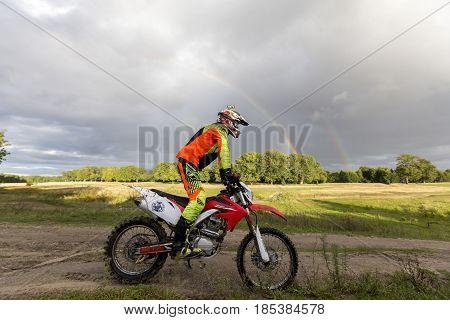 Nizhny Novgorod, RUSSIA - MARCH 10, 2015: Training Run a young athlete on a motorbike through rough terrain. Russia