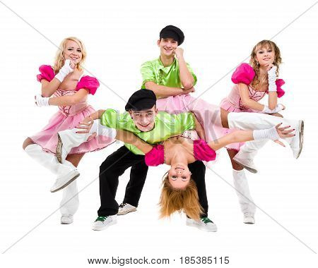 dancer team wearing wearing a folk russian costume posing against isolated white background
