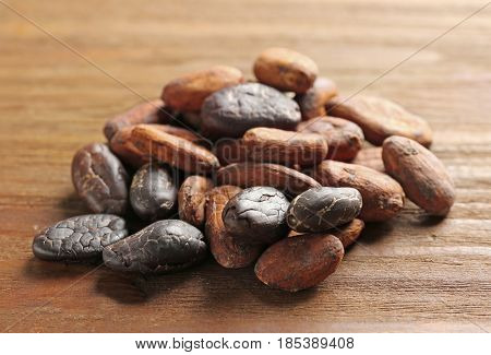 Aromatic cocoa beans on wooden table