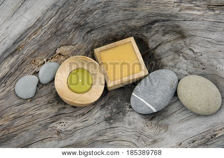 nature driftwood wood and handmade candle with gray stone,