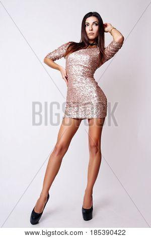 Portrait Of Beautiful Brunette Woman In Pink Dress. Fashion Photo Shot.