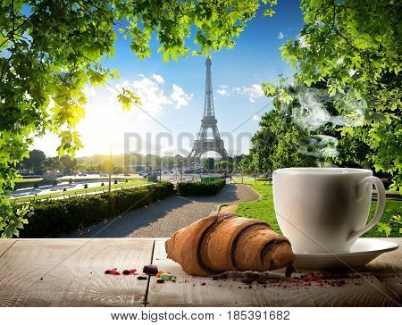 Traditional parisian breakfast with the view on Eiffel Tower and Trocadero Gardens, France