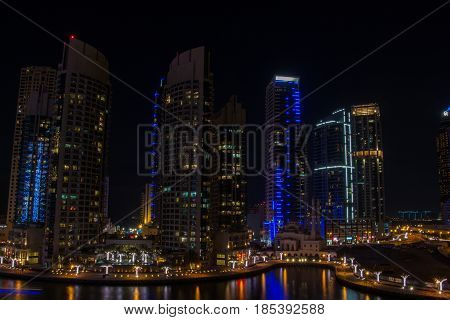 Dubai marina canal located in uae Persian gulf at night