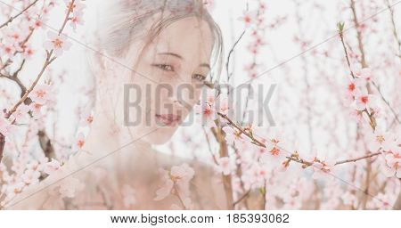 Double exposure image of portrait beautiful asian young woman and blossoming trees.