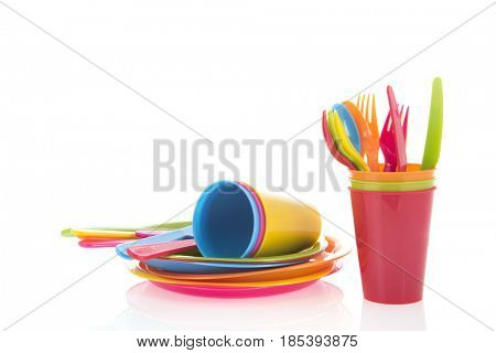Picnic crockery and cutlery in all colors isolated over white background