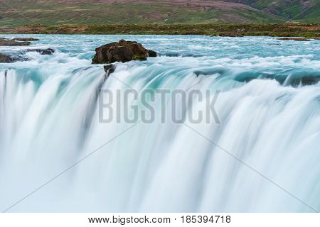 Fragment of the waterfall cascade Godafoss. Tourist attraction of Iceland