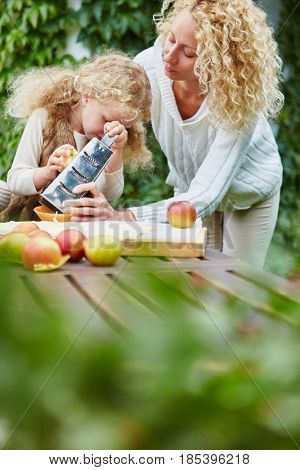 Mother help daugther rub apples as team and support