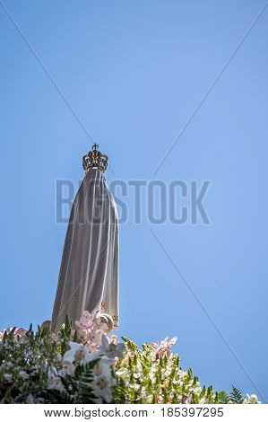 The Statue of the Virgin Mary at the Sanctuary of Fatima during the celebrations of the apparition of the Virgin Mary in Fatima Portugal.