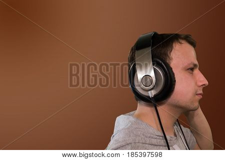 Profile Of Young Man Listening To Music With Headphones, Enjoying In Nature, Graded