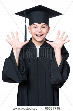 Portrait of a graduate teen boy student in a black graduation gown with hat - isolated on white background. Child back to school and educational concept.