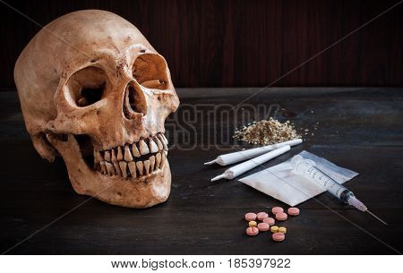 Old Skull With Marijuana , Dangerous Of Drugs , Drugs And Syringes , Drugs And Crime Concept.