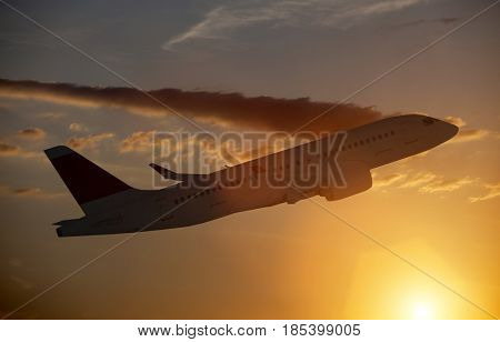 Airplane in flight and the sunset