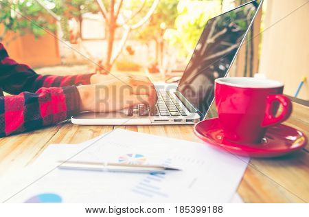 Business concept with money and documents graph report finance businessman writing graph