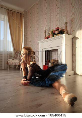 Beautiful Young Woman Ballerina Stretching Warming Up In Home Interior, Split On Floor, Side View