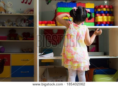 Eskisehir, Turkey - May 05, 2017: Little Girl In Dress Playing With Toys In Kindergarten