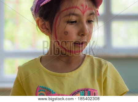 Eskisehir, Turkey - May 05, 2017: Preschool Little Girl With Yellow T-shirt Posing In Classroom.