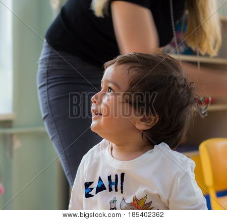 Eskisehir, Turkey - May 05, 2017: Sweet Little Boy With His Mother Behind In Kindergarten Classroom