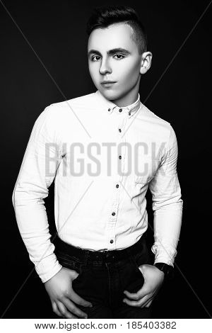 Fashion Photo Of Young Model Man On Black Background. Boy Posing. Sports Guy. Studio Photo. Black An