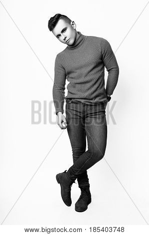 Fashion Photo Of Young Model Man On White Background. Boy Posing. Sports Guy. Studio Photo. Black An