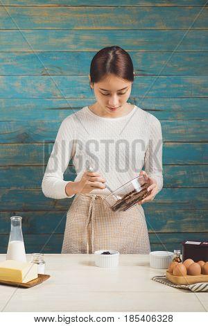 House Wife Wearing Apron Making. Steps Of Making Cooking Chocolate Cake. Preparing Dough, Mixing Ing