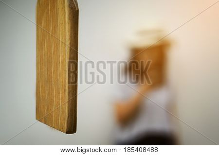 Close up of Wood Bell Lumber and blurred woman background.