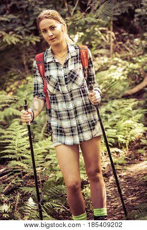Beautiful young blond woman hiking
