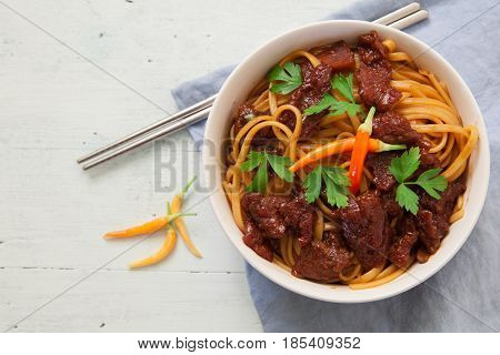Thai noodles with beef and hot red chili pepper