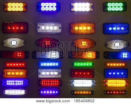Abstract background of halogen multicolored plastic light bulbs