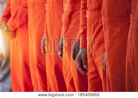 Discipline in standing upright with uniform orange color.
