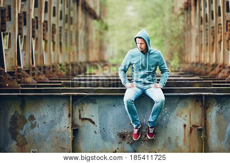 Sad Man On The Abandoned Bridge