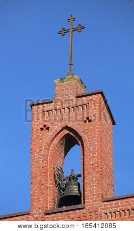 Bell And Cross Of Clinker Church In Koelzin, Mecklenburg-vorpommern, Germany
