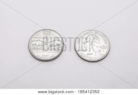 Closeup To Utah State Symbol On Quarter Dollar Coin On White Background