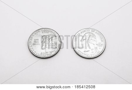 Closeup To New Hampshire State Symbol On Quarter Dollar Coin On White Background