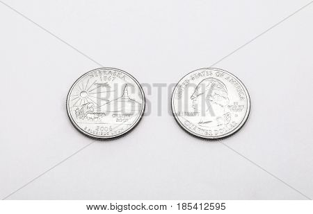 Closeup To Nebraska State Symbol On Quarter Dollar Coin On White Background