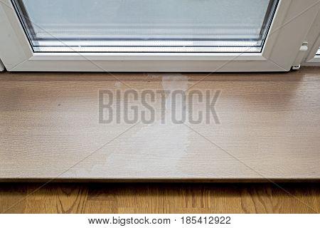 Acetone damaged on wooden doorstep, entrance to terrace