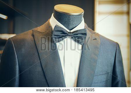 Closeup of black luxury tuxedo with bow tie