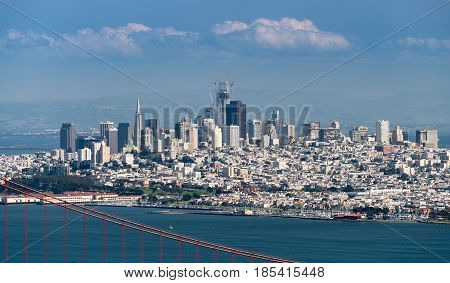 Telefoto image of the suspension of Golden Gate Bridge and San Francisco taken from Marin Headlands on clear spring day
