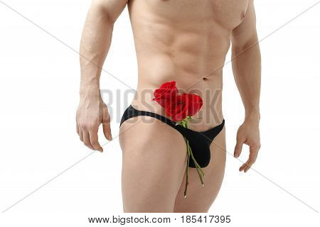 Handsome man holding a red rose and a bouquet of red roses. Sexy man gives a rose on a white background with a beautiful light. Isolated on white background