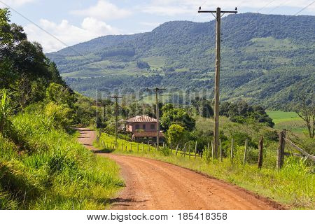 Farm House In Dirt Road