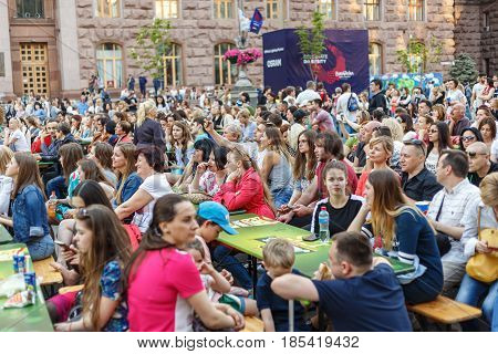 People are resting in the fan zone of Eurovision 2017 on Khreshchatyk Street in Kiev. Eurovision Village. Eurovision opening in Ukraine. May 7 2017