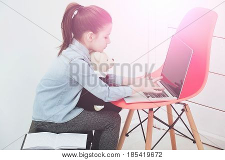 Girl Or Cutegirl Hugging Teddy Bear And Typing On Laptop