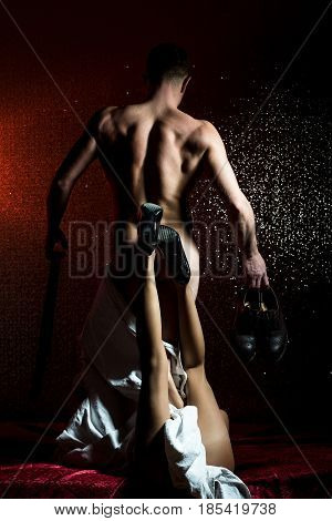 Muscular Man With Sexy Woman Holding Fashionable Leather Shoes, Belt