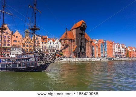 Pirate ship and historic port crane at Motlawa river in Gdansk, Poland