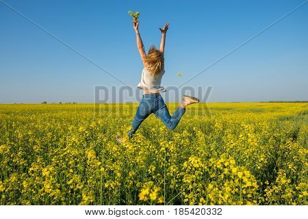 Amazing Young Woman, Blonde Jumping And Having Fun In A Field
