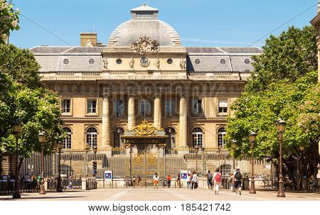 Paris, France - July 09, 2016:The Palace of Justice with unidentified people. The palace is a historical building on the Ile de la Cite, that houses today various courts.
