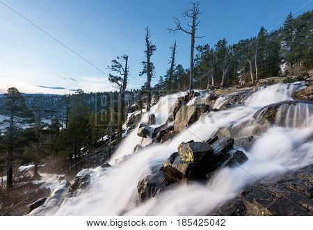 Sunrise at Emerald Bay on Lake Tahoe from the top of Lower Eagle Falls. Torrent of water from snow melt flows into the lake from Sierra Nevada Mountains