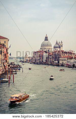 Beautiful view of the Grand Canal and the Basilica di Santa Maria della Salute taken from Ponte dell'Accademia Venice Italy.