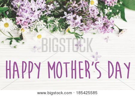 Happy Mother's Day Text Sign. Greeting Card. Gentle Pink Lilac Flowers And Daisy On White Rustic Woo